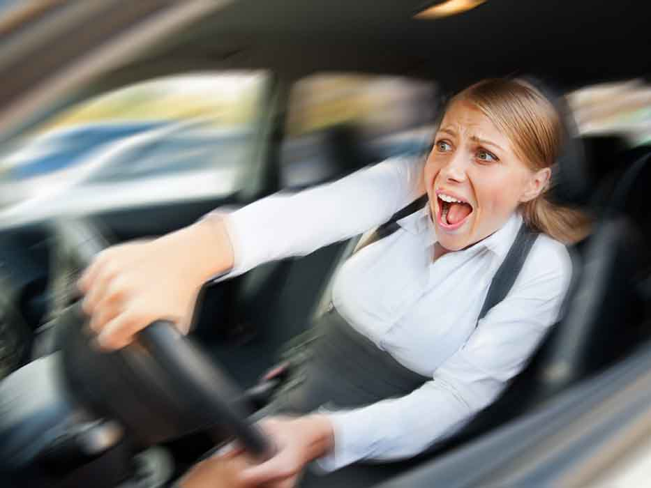 female driving the car and screaming
